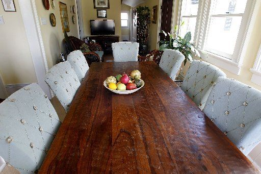 A Long Narrow Dining Table From Reclaimed Wood